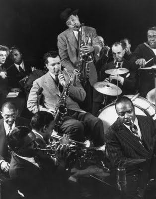 Count Basie on piano, Lester Young standing   KC Jazz.