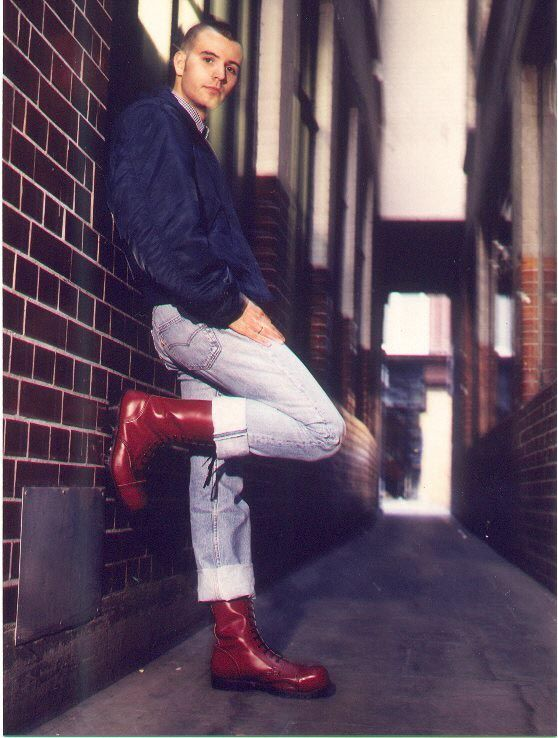 OG style skinhead in Cherry red Boots, and rolled up jeans.