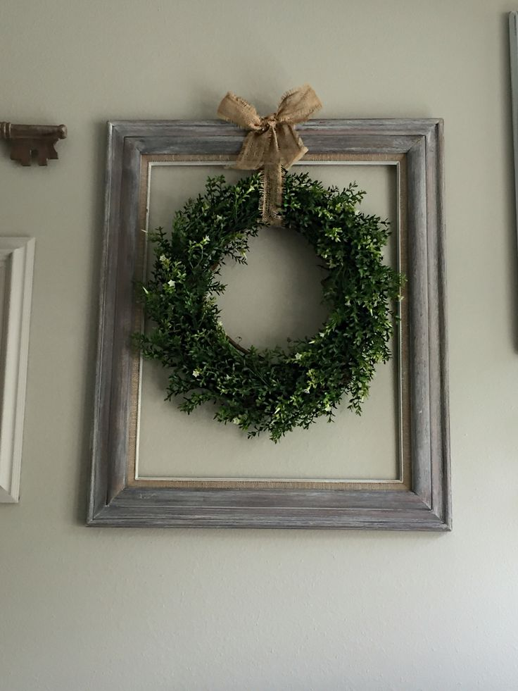 Made this using a goodwill 5.99 dark wood frame I white washed. Wreath and garland from Michaels and dollar store burlap ribbon!! ❤️❤️❤️❤️
