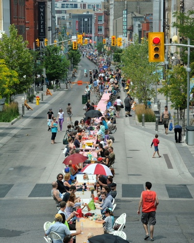 Tables snake along King Street in Kitchener on Sunday during the World's Longest Picnic attempt.