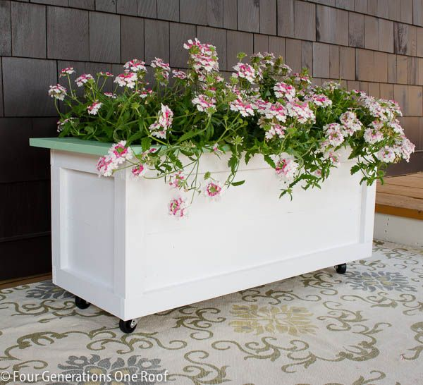 How to make a large wooden outdoor diy planter on wheels using pressure treated wood. Step by step instructions by a father and daughter building together.