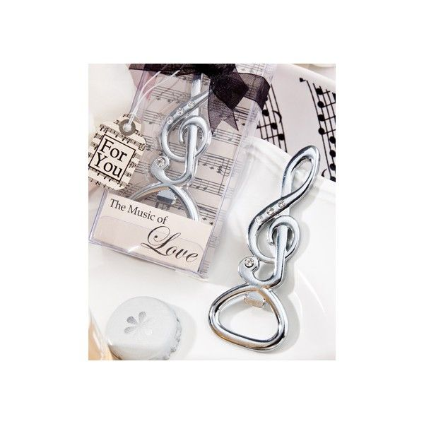 Elegante apribottiglia in metallo decorato con brillantini,   Misura circa 7 cm e confezionato in una scatola trasparente decorato con grafica  con note musicali.