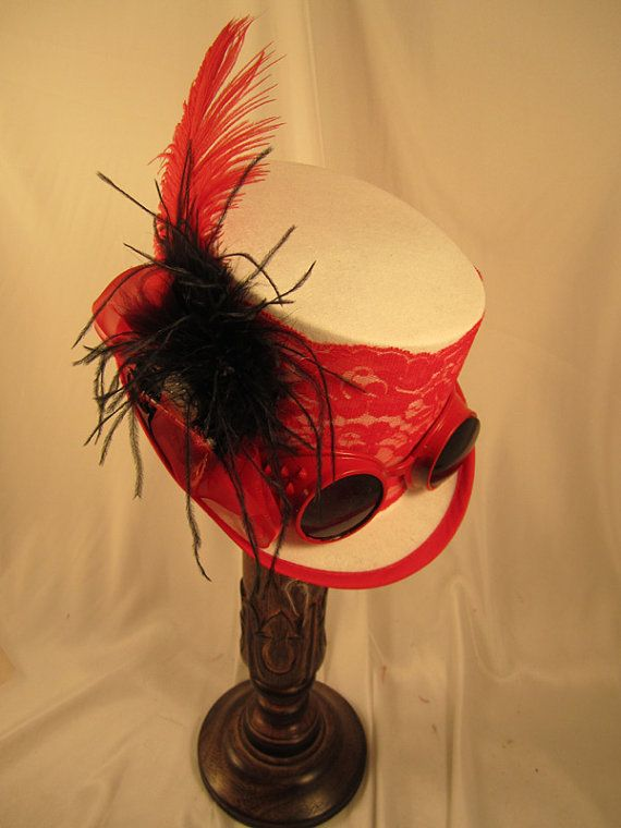 New Steampunk White & Red Riding Top Hat. White Riding hat with red lace band around the hat, clock parts, black ostrich and red ostrich plume. The