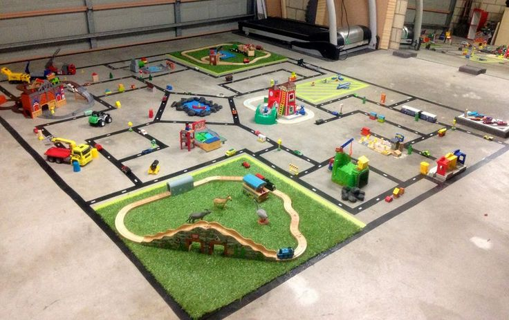 Using black tape and my sons car/train toys, I created this mini world inside the garage for his birthday