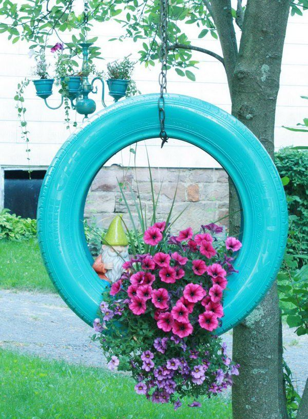 Hanging tire flower planter.
