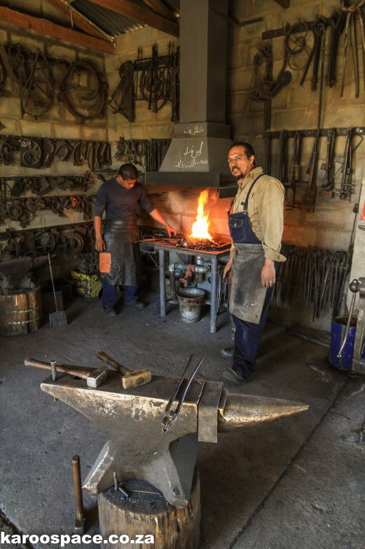 Kashief Booley and Ishmael Hanief, blacksmiths at the forge, in Prince Albert, just a little walk from Karoo View Cottages - a must visit