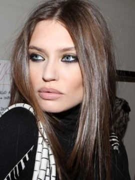 Soft beige brown hair with hint of warmth.  Great for blue eyes.