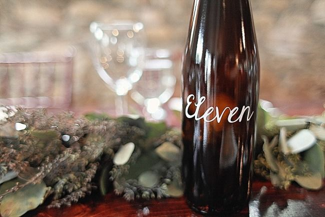 Wine bottle table number is perfect for a vineyard reception
