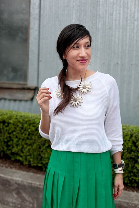 Apsara Baldovino, senior account manager. Vintage green pleated skirt, Zara T-shirt, Zara White fine knit jumper, Costume National heels, Adorne Daisy chain necklace, TW Steel watch.
