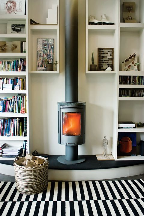 """compact wood-burning stove in a small studio - Voronova says. """"Good looking, easy to control, very economical, and environmentally friendly, too!"""" Proof positive that it's not the size of the space that counts, it's how you choose to heat it."""