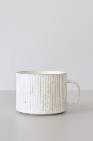 Hand-thrown Shigaraki porcelain cup by Japanese ceramicist Taira Kuroki. Soft lines add texture and an earthy, natural feel. Comfortable to hold and perfect for a morning cup of coffee or tea. Cups ar