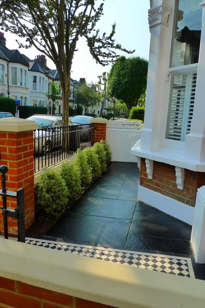victorian terrace black limestone paving and red brick london garden wall l with mosaic black and white tile path