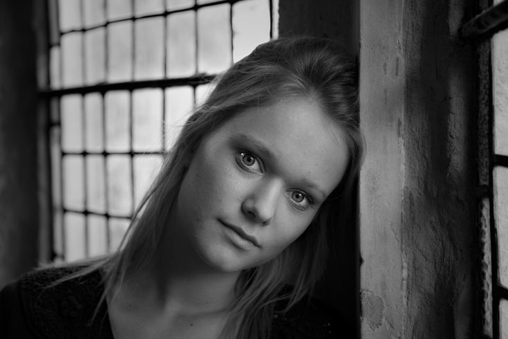A lovely, delicate black and white portrait of a young woman by window light in Melbourne, Australia.