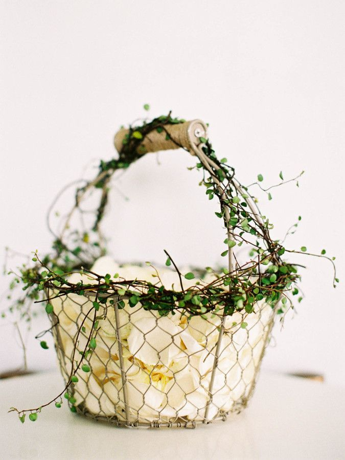 Organic wire flower girl basket: http://www.stylemepretty.com/2017/02/24/a-classic-oscar-de-la-renta-dress-set-the-tone-for-this-half-moon-bay-soiree/ Photography: Jen Huang - http://jenhuangphoto.com/