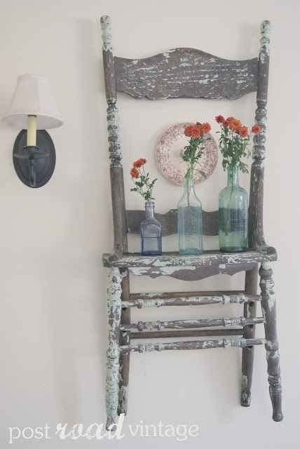 Tattered old Chair.. Turned Shelf! LOVE IT!!!!! You can use the bottom half for a towel rack!!!