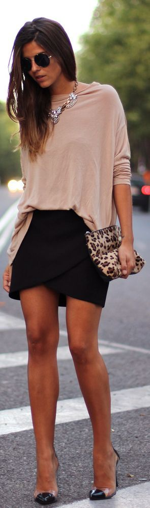 Perfect comfy and sexy combo.   Black skirt, nude top, statement necklace, and heels.