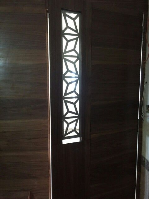 Delandita Walnut Veneer Door Maindoor Brushedsteel Grill Lasercut Interiordesign Mumbai My Work Interior Design Pinterest Doors And Mumbai