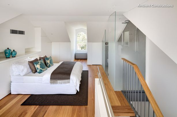bedroom on stairs with bathroom