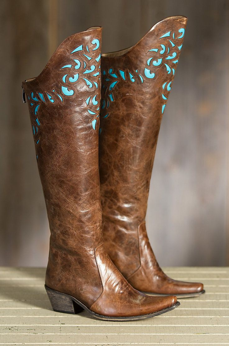 """These artistic vintage leather boots are handcrafted with a deluxe 20"""" shaft in a laser-cut design, finished with turquoise leather accents."""