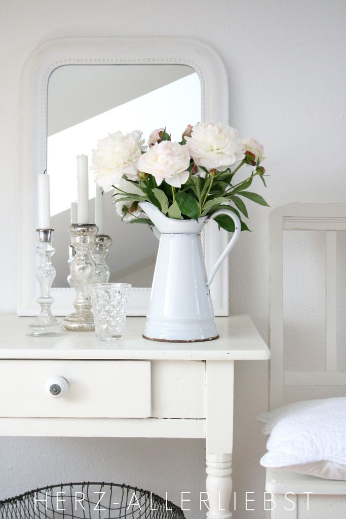 .So pure and gentle. The pitcher with the flowers are a perfect touch.