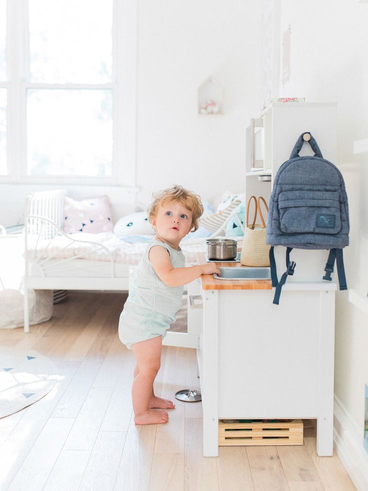 Scandinavian shared kids room - light-filled, pastel baby + toddler playroom - Ikea hack play kitchen | Happy Grey Lucky