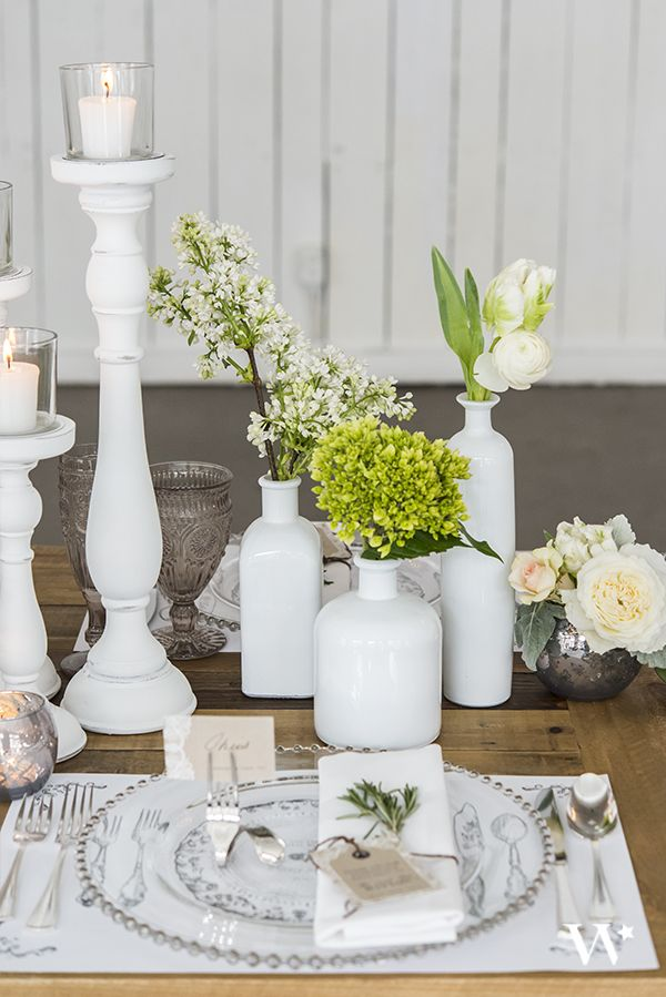 The clean, vintage style of these white glass bottles pair wonderfully with Shabby Chic Spindle candle holders. Add a Twisted Fork Vintage Inspired  stationery holder to create a Rustic Glam look for your table settings.
