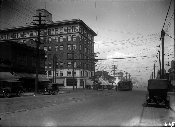 Mount Pleasant  - 1922  Looking North on Main at Broadway  VPL Accession Number: 5278  Photographer / Studio: Timms, Philip  Content: View looking North on Main from near Broadway. The Lee Building at 175 East Broadway is on the North West corner of the intersection. Businesses which are visible include:  W.S. Law Druggist - 2449 Main  A. Hilker & Son Drygoods - 2425 Main  Broadway Rooms - 2339 Main  http://www3.vpl.ca/spe/histphotos/