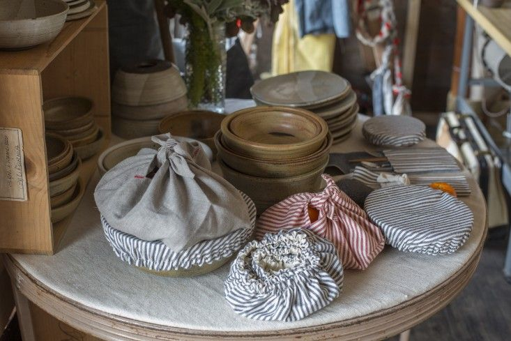 Ambatalia shop Mill Valley | Remodelista. Bowl covers on display with ceramics.
