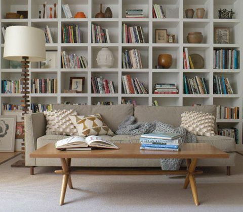 Oh, how I need a full wall bookshelf! Books Movies, Colorful vases, Pictures!!