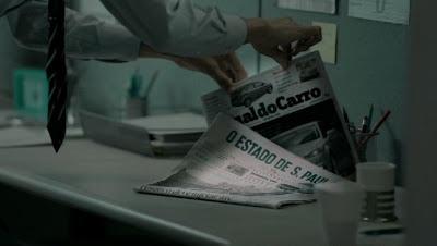 Campanha para o Jornal do Carro apresenta jornal sendo monitorado por alarme.