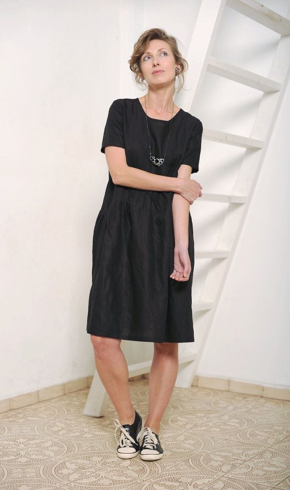For this dress I used linen fabric. It is black and has very delicate almost unnoticeable silver shiny effect. It has round neckline and gathered diagonal skirt.