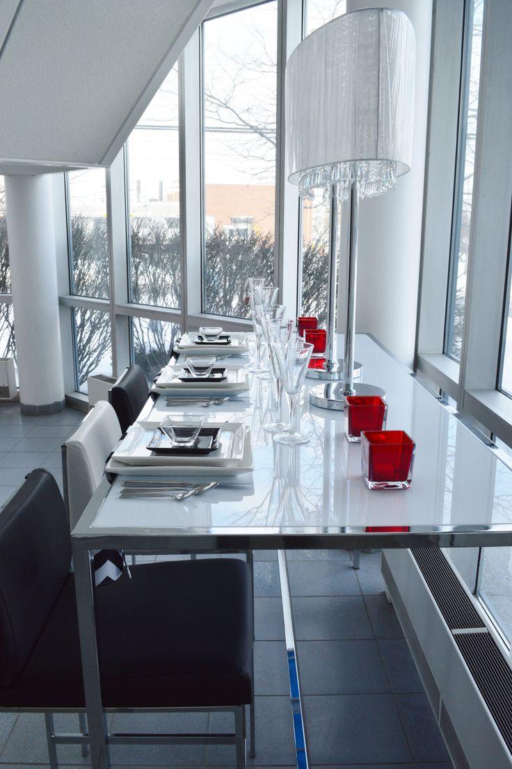 "White Plexi Communal Table, Black & White Nova Barstools, Square White China, Black Square Side plate, Milano Flatware, Bormioli Glassware, Red Glass Urban Cubes 3 x3""  & Black/White Chevron Napkin   Chair-man Mills   Centre piece : Crystal World"