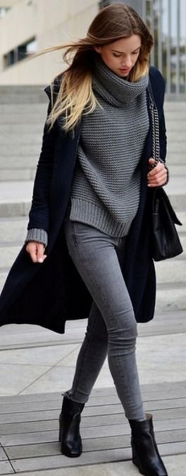 Love the grey and black combination. The oversized grey sweater looks great against the long black coat.