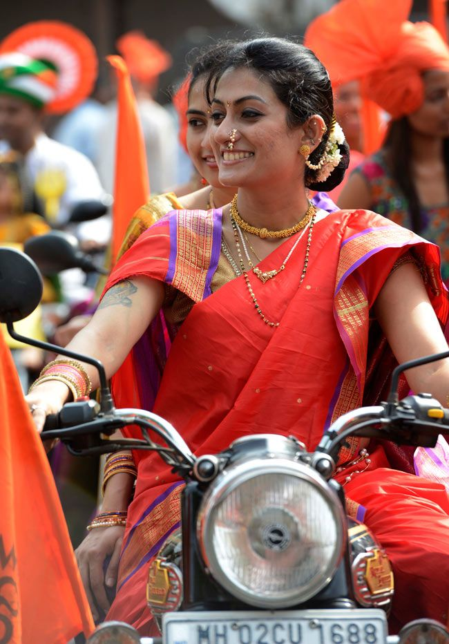 A Maharashtrian woman, Dr Aparna Bandodkar rides a bike during Gudi Padwa celebrations in Mumbai on Thursday, April 11, 2013.. What a lovely smile !