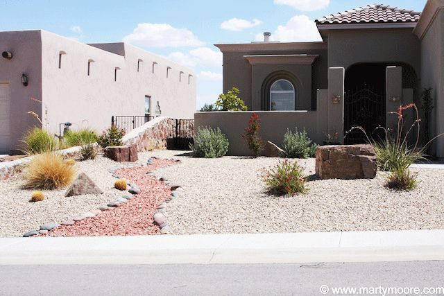 Desert landscaping with different colored rocks outdoors for Different landscaping ideas