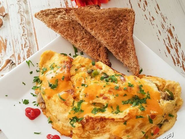 Simple Omelette Recipe Breakfast and Brunch with extra large eggs, mushrooms, chopped bell pepper, cheddar cheese, milk, baking powder, butter, salt, pepper