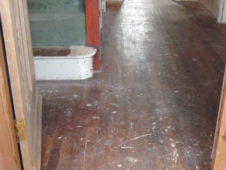 Old varnished Hallway covered with plastering and decorator's mess