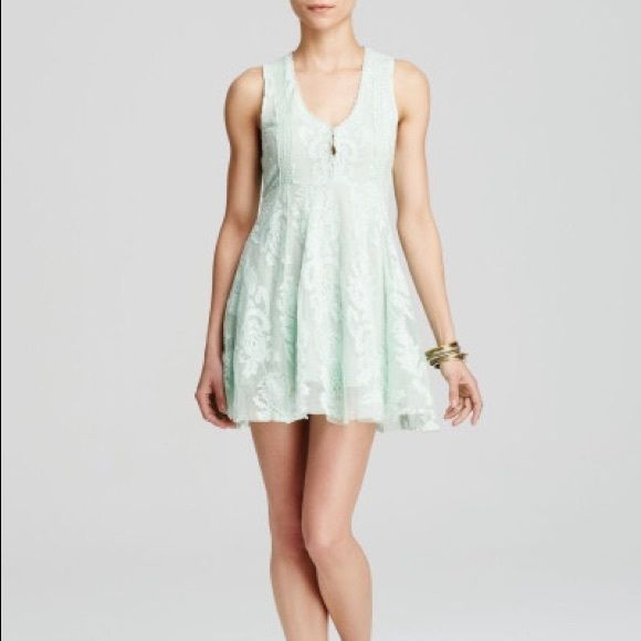 Free People Dress - NWT - sizes 0 and 2. Free People embroidered mesh dress - NWT - sizes 0 and 2.  Gorgeous sea green color. Front hook closures and hidden side zipper. Because of the stretch, this may run a tiny bit big so the size 0 could fit 0-2 and size 2 could fit sizes 2-4.  This dress is so comfortable, not to mention beautiful! Sold out! Free People Dresses Mini