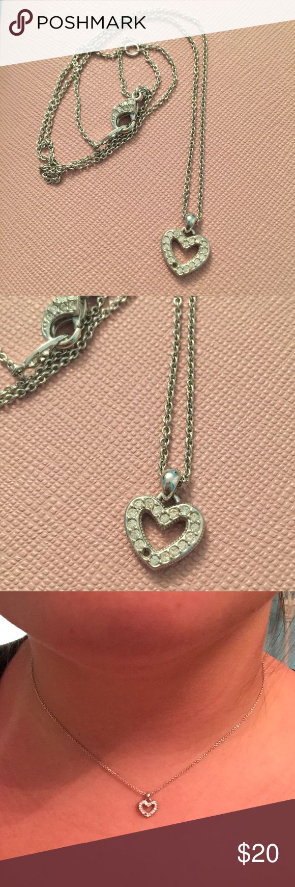 Sterling Silver Diamond Heart Necklace Beautiful authentic sterling silver heart necklace! Diamonds are not real but great quality. Only flaw in the necklace is that it is missing a diamond but it is barely noticeable. Great necklace to give a loved one or wear for yourself :) comment with any questions! Lord & Taylor Jewelry Necklaces
