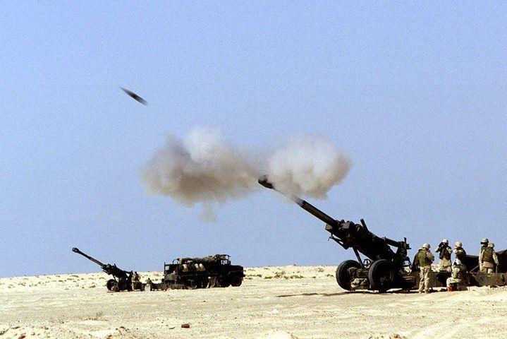 A 155 mm M198 howitzer firing a shell.
