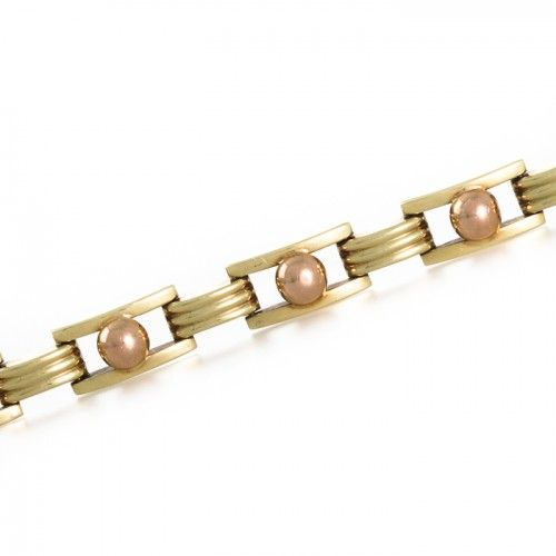 A retro bracelet made in 14ct yellow gold made as a series of open rectangular links each with a slight dome across the polished surface each framing a polished rose gold bead all joined by smaller rectangular links with a triple ribbed effect to the top one of which conceals the push clasp fitted also with a safety catch stamped 'RS 585'. Length: 19cm Weight: 14.2grams #Rutherford #Melbourne