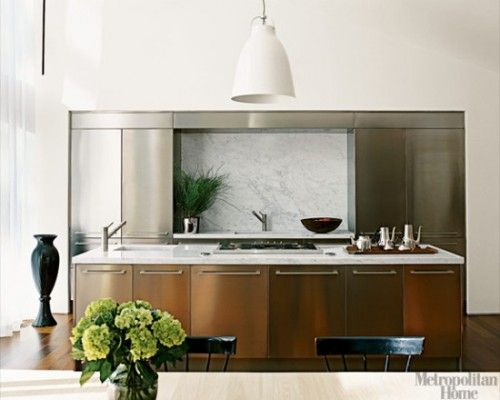 contemporary kitchen with stainless steel cabinets by varenna and marble island counter top - Elle Decor Kitchens