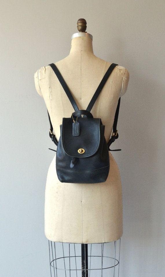 Vintage black Coach mini backpack with brass hardware and adjustable straps.  --- M E A S U R E M E N T S ---  9 Height x 8 Length x 5 depth