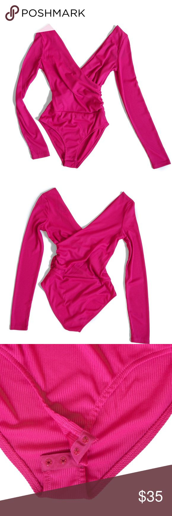 TopShop Ribbed Surplice Bodysuit -Magenta • Brand new with tags, originally $38  • A plunging surplice neckline defines a long-sleeve bodysuit in an ultra-stretchy ribbed knit for a flattering, no-slip base layer.  • Surplice V-neck • Long sleeves • Fabric Content: 95% polyester, 5% elastane • Machine wash cold, dry flat • Color: Magenta (*photos reflect slight variations in color due to different lighting) • Snap closure on bottom, seam at waist, would look best outfitted with high-waisted…
