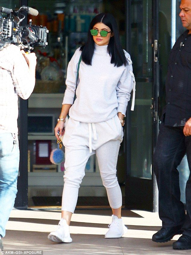 Co-ord queen: The youngest member of the Kardashian-Jenner clan's two-piece comprised white-grey harem-style jogging bottoms and a matching high-neck jumper