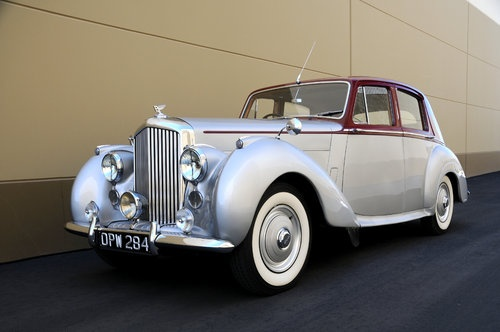 1953 Bentley... Like the one that we left our reception in. (it was mint green)