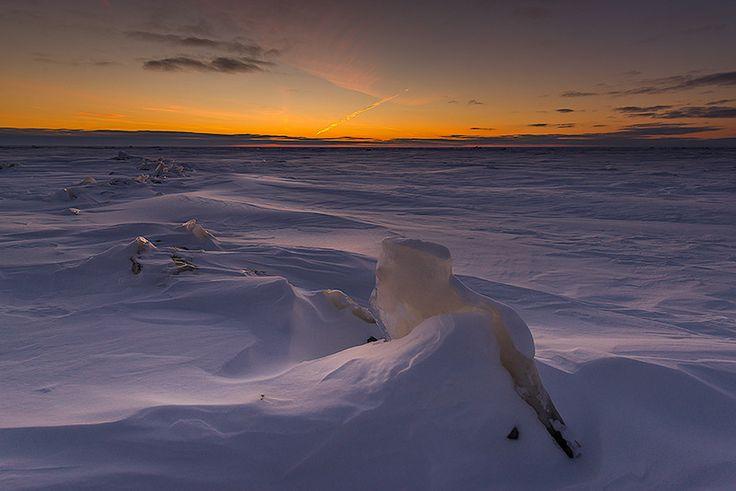 Winter sunset over Lake Winnipeg. Photo by Nebojsa Novakovic.