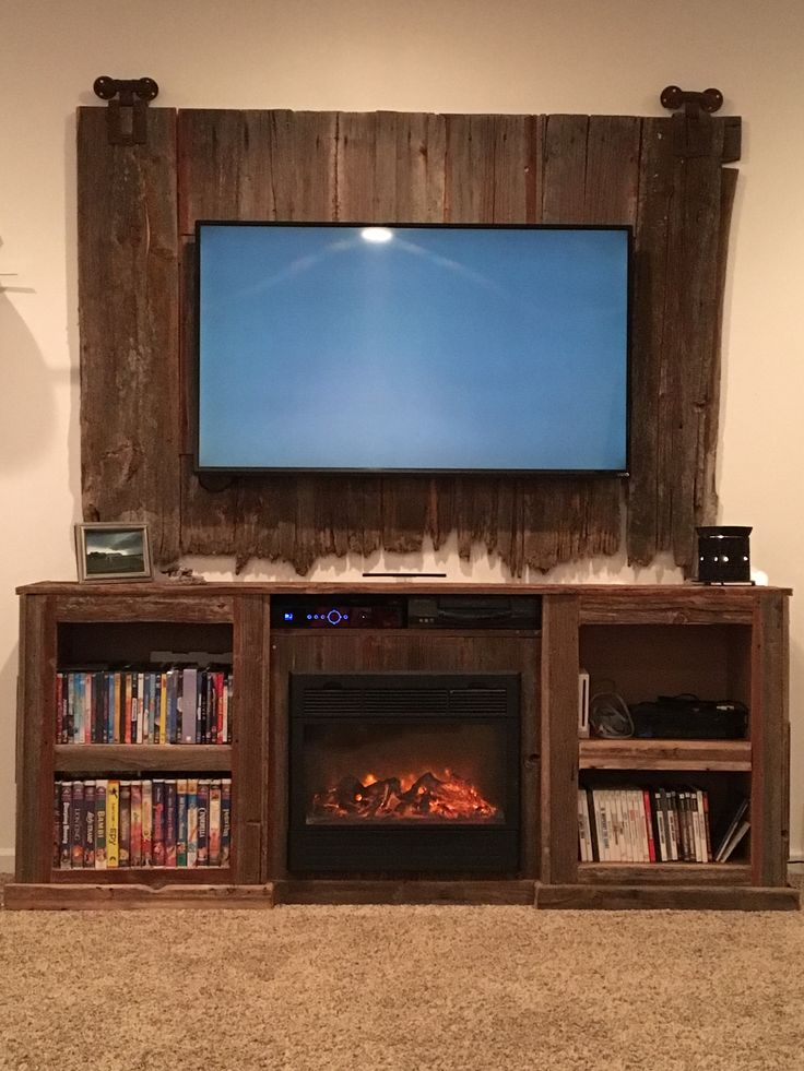 Barn Wood Entertainment Center With Fire Place Insert Tv