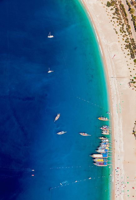Ölüdeniz, Turkey in a captivating image that provides a wide color contrast in addition to exposing a great sandy beach with clear water.