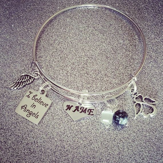 Check out this item in my Etsy shop https://www.etsy.com/listing/280578802/i-believe-in-angels-personalized-charm